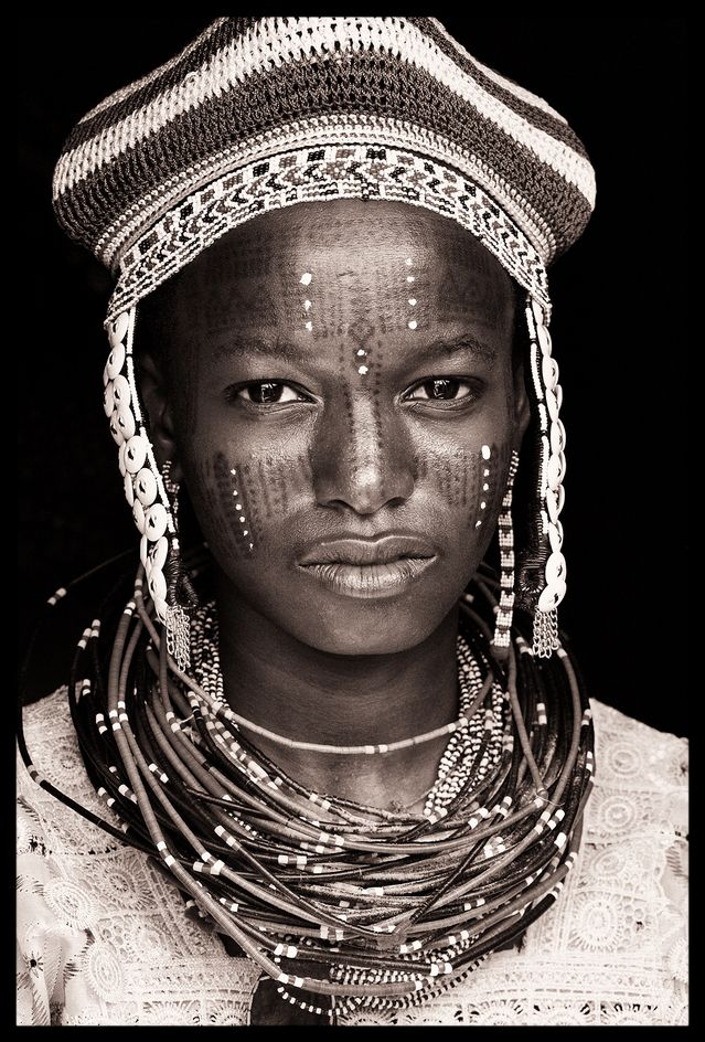 "Portrait from 'West African Societies' by John Kenny courtesy of john-kenny.com ""Black and white portraits from some of West Africa's most remote societies, including the Wodaabe and Fula in Niger, the Tuareg in Mali, the Tamberma in Togo and the Betammaribe in Benin, who practice a uniquely intricate form of facial scarification.I spent two months travelling through the arid Sahel on the southernmost fringes of the Sahara. An area of little development interest provides"