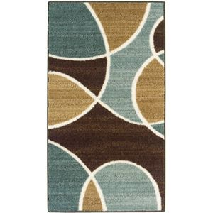 Put in a new rug like the Hometrends Geo Waves Nylon Rug, Aqua at Walmart to freshen up your living room