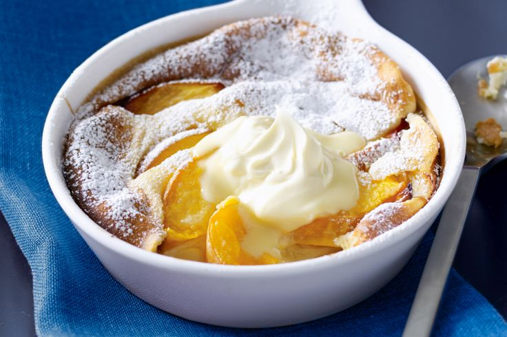 Beat the budget with warm peach, soft pudding and lashings of cream.