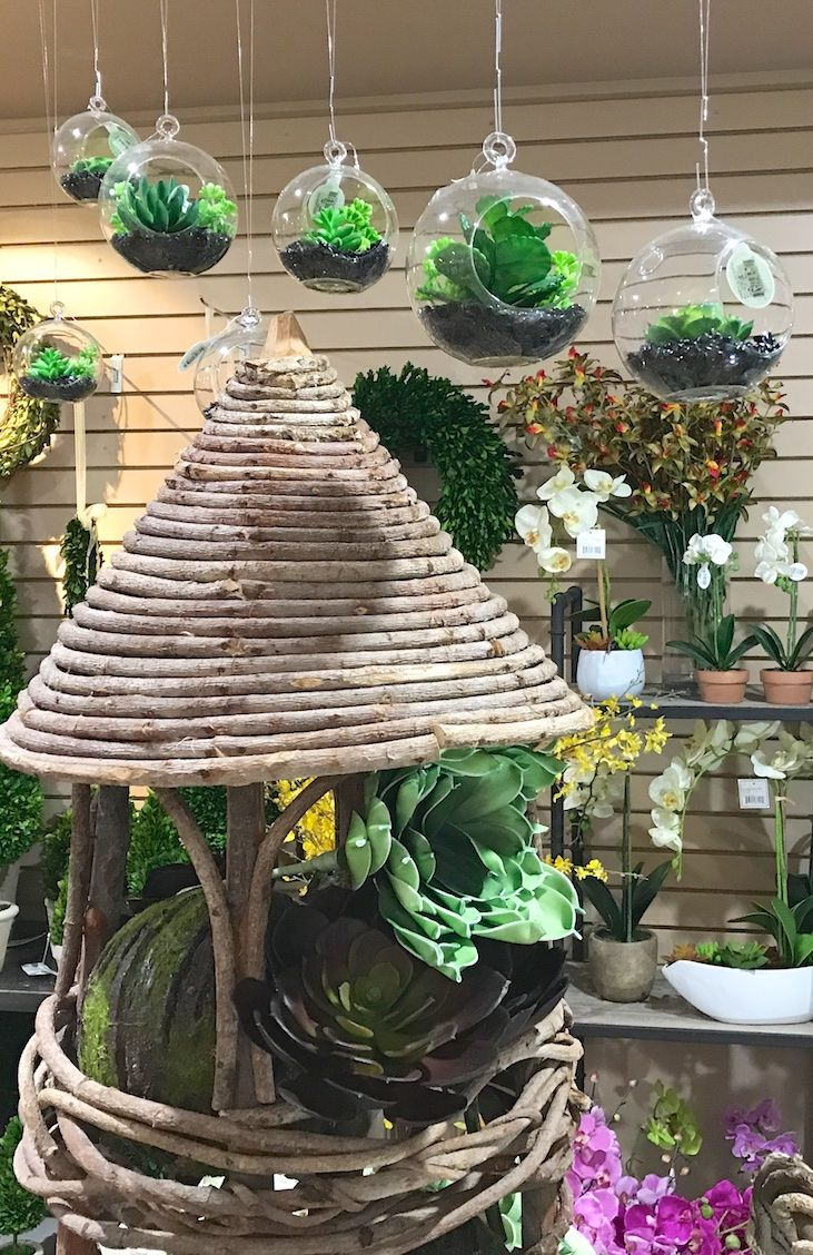 succulents hanging in a glass globe...faux ( We carry a huge selection