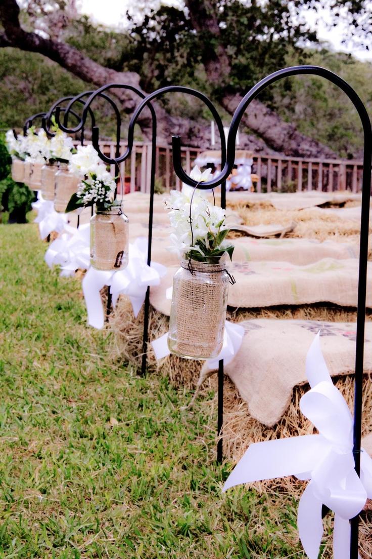 My Wedding Aisle.  Home-made Sheppards hooks and homemade mason jar decor made by my mom and I!