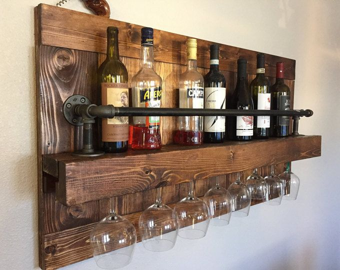 Reclaimed pallet wood wine rack. Rack is handmade one piece at a time. Each piece of wood used is hand selected for its unique character and grain style. All wine racks are slightly sanded to prevent large slivers and snagging rough wood. Wine and glasses not included.. STANDARD WINE RACK SIZE: 37 inches long 18 tall 6 inches deep -Dimensions are approximately PLEASE NOTE: The photos provide a representation of what will be made for you upon order. Slight variations are to be expected. We...