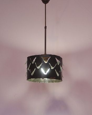 Handmade ceiling lamp made of oxidized copper.