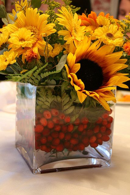 Wow option red and yellow sunflower centerpiece