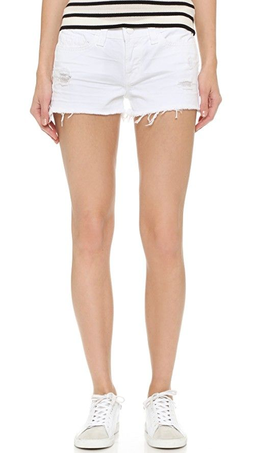 J Brand 1046 Cutoff Shorts | Exclusive to Shopbop. Shreds and a raw hem lend well-traveled appeal to cutoff denim shorts. 5-pocket styling. Single-button closure and zip fly. Fabric: Denim. 100% cotton. Wash cold. Made in the USA. Measurements |  Rise: 8in / 20.5cm Inseam: 2in / 5cm
