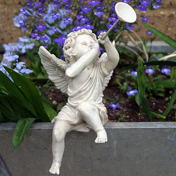 Sitting Cherub Blowing Horn (Left) - Garden Ornament Or Home