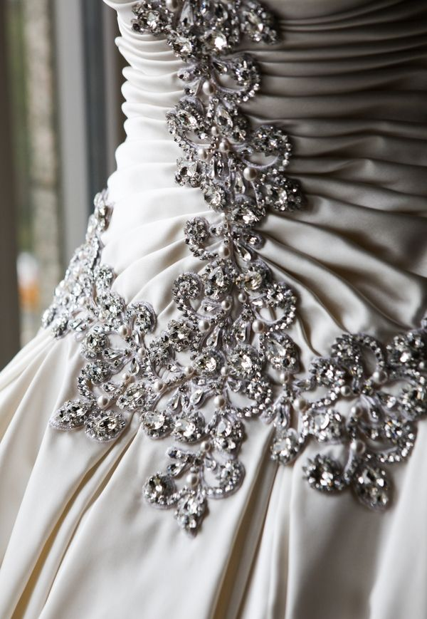 The Traditional Satin Wedding Gown Featured Crystals Pearls And Platinum Embroidery On Bodice