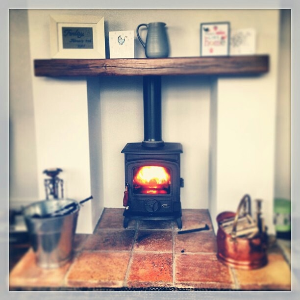 Wood burner. Reclaimed quarry tiles. Reclaimed pitch pine beam.