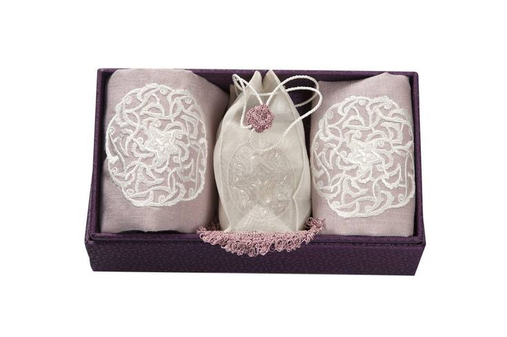 Another gift idea could be a soap in a classy organza bag accompanied by two embroided hand towels....