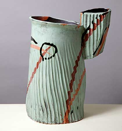 Allison Britton , a ribbed pot with a large hollow handle fixed to its neck