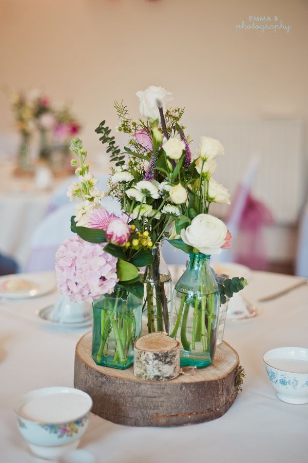 Woodland wedding...flower grouping that makes it look like a tree with small bottles of varying heights,,,