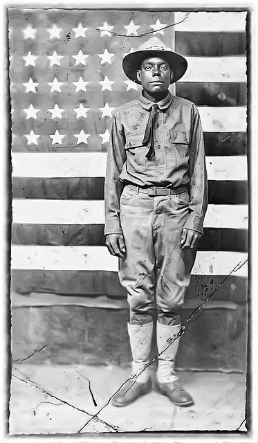 We send our children to war.    World War I Soldier With American Flag In Background Between 1914 and 1918 by vieilles_annonces, via Flickr