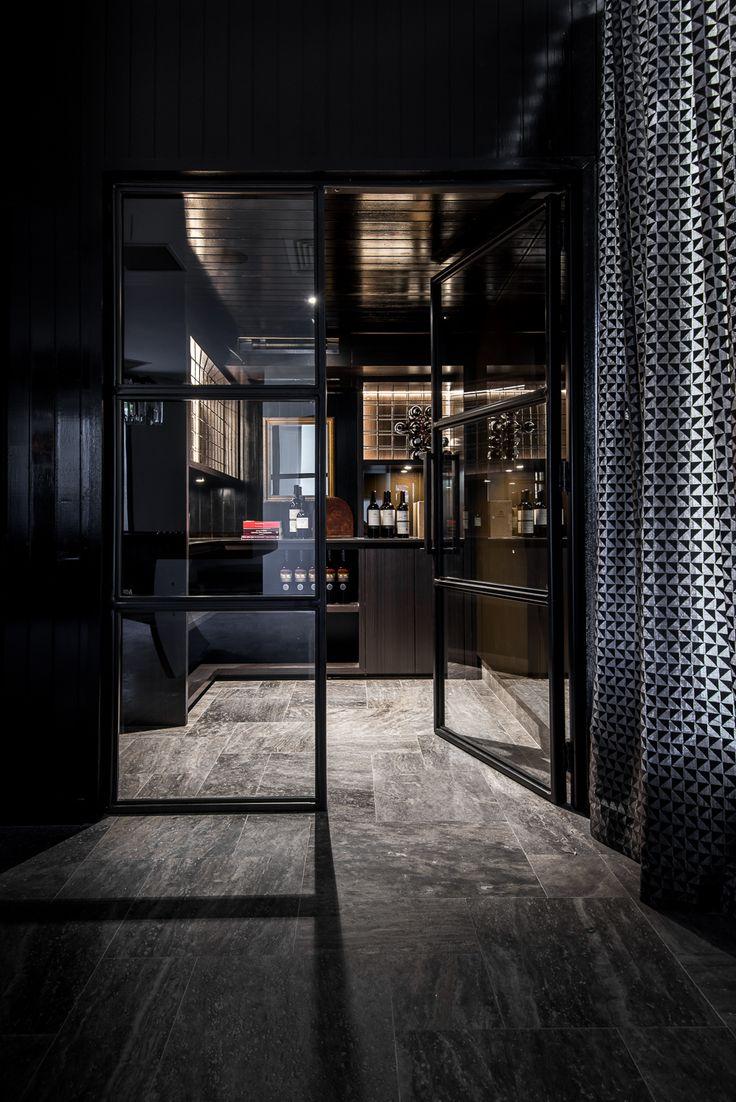 Applecross Residence by Studio Atelier - Moody wine cellar