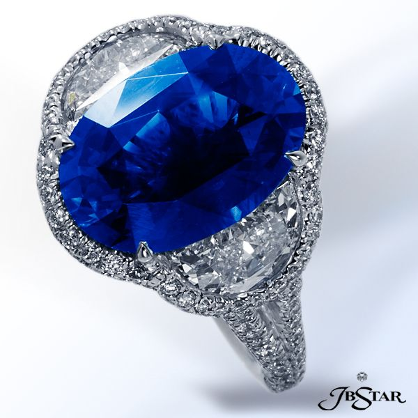 JB Star Platinum sapphire ring featuring a stunning oval sapphire embraced by two half-moon diamonds and encircled with pave.
