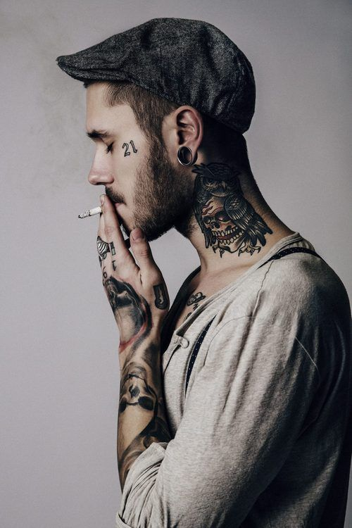Why do sexy guys with tattoos and piercings always smoke? It's so attractive. ;)