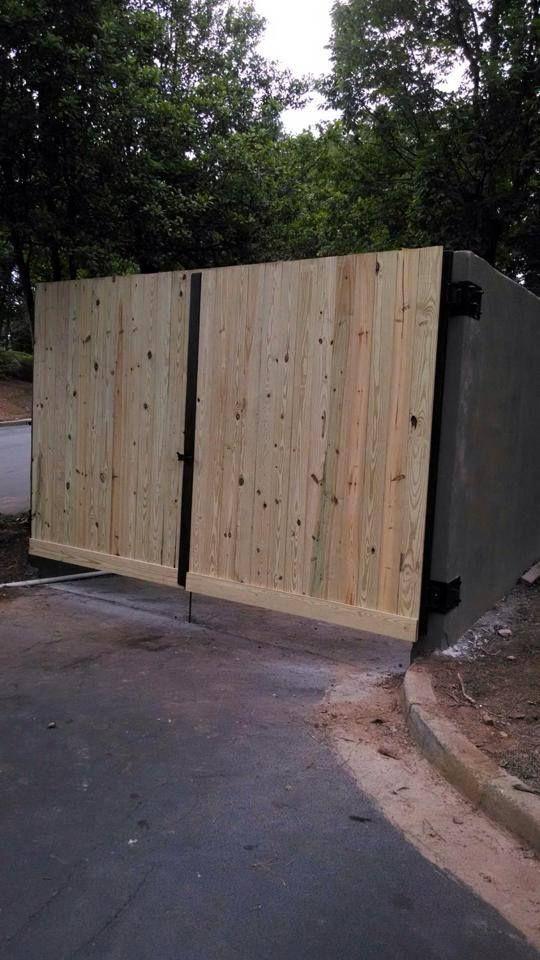 Wood steel dumpster gates wood steel gates pinterest for Garage door repair round lake il