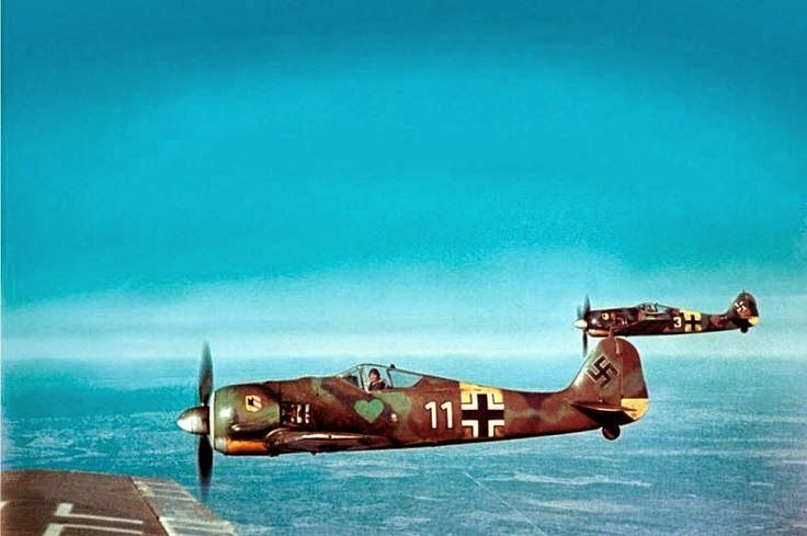 Beautiful color image of the German Focke-Wulf Fw 190A-5 fighters, of Fighter Squadron JG54, during flight, 1943. -