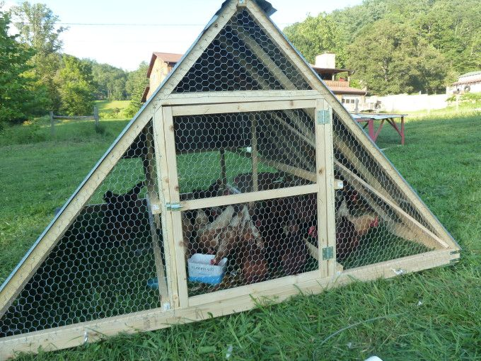 I've used Harvey Ussery's A-frame design for years (it houses about 30 chickens).   Some folks, like Geoff Lawton, convert small trailer frames into coops while Joel Salatin is famous for his large egg-mobiles. http://www.themodernhomestead.us/article/Building+a+Pasture+Shelter.html