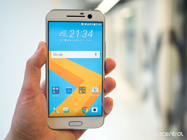 White HTC 10 smartphone in a man's hand. Customize this image with your app's screenshot with just a few easy clicks on PicApp.net