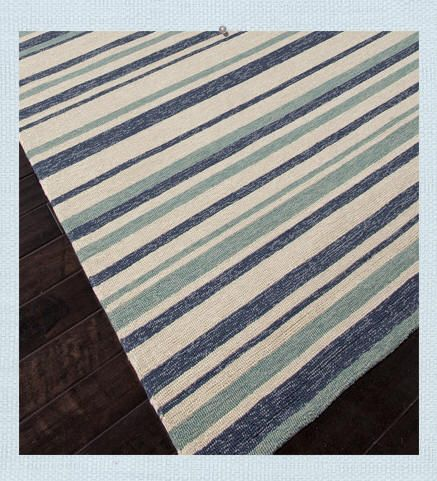 Coastal Living Indoor Outdoor Rug. The official Coastal Living Earn Your Stripes rug is designed to add a beach feel to indoor and outdoor spaces. Created for high traffic areas or outdoor weather exposed spaces. Available in 4 sizes.