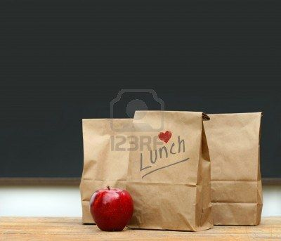 http://www.123rf.com/photo_5221666_paper-lunch-bags-with-red-apple-on-school-desk.html