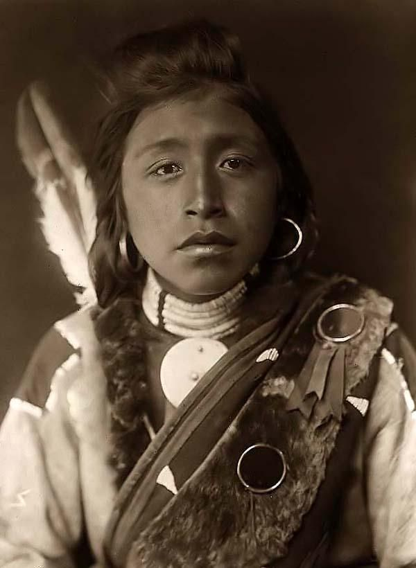 Here we present a stunning image of Kashhila. It was taken in 1910 by Edward S. Curtis.    The image shows a Wisham Indian Boy with a Feather on his back.    We have created this collection of images primarily to serve as an easy to access educational tool. Contact curator@old-picture.com.    Image ID# 385D6A14