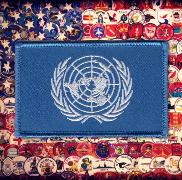 United Nations UN Flag Patch - White world map with two olive branches on blue background.