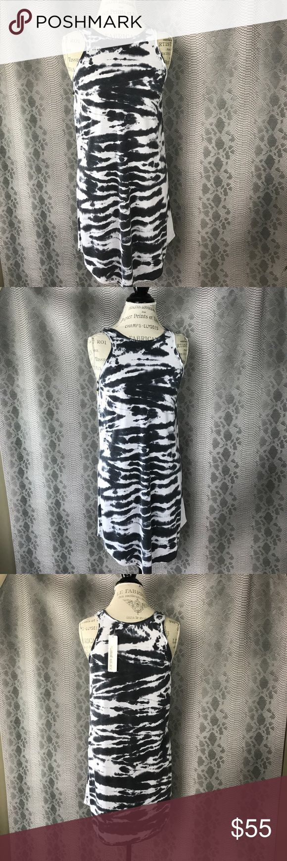 Saint Grace tie dye tunic, cover up Boutique Saint Grace tunic, cover up, top, dress, blackcaps & white tie dye, comfy feel   ||  Boutique  ||Bundle for a discount   ||  5 star ratings  ||  Fast shipper ||  100% authentic             N OTRADES  Tags: t shirt, tunic, tshirt dress, coverup, bathing suit cover up, tank dress saint grace Swim Coverups