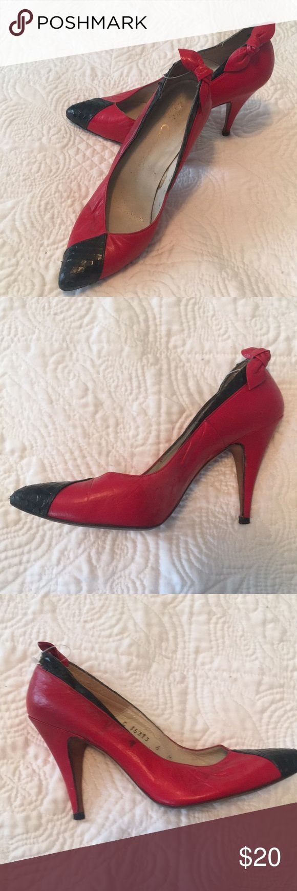 Cute vintage red and black heels with bow size 6 Cute vintage red and black heels with bow size 6. 3.5 inch heel height. These heels are vintage so have some natural wear to them. Shoes Heels