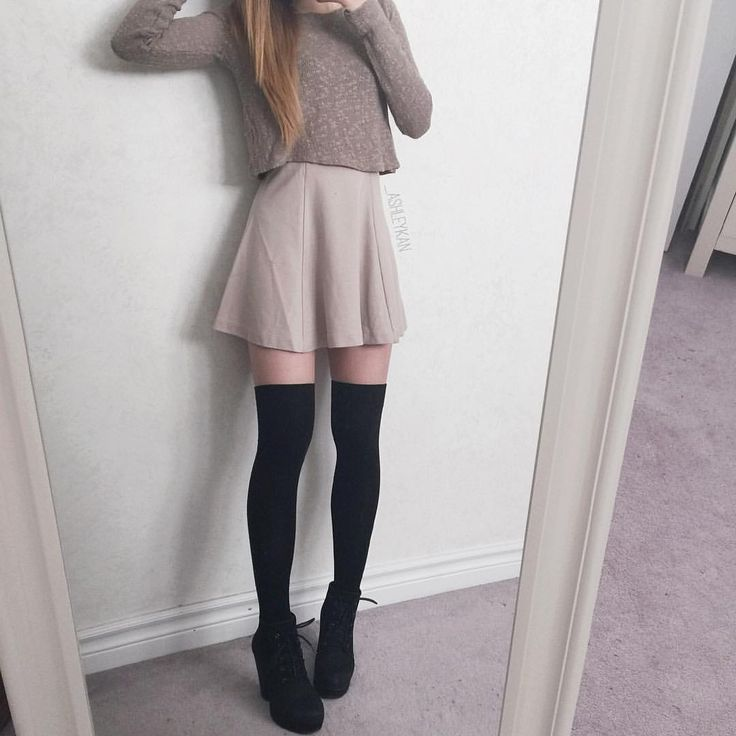 a high waisted skirt and thigh high socks with booties