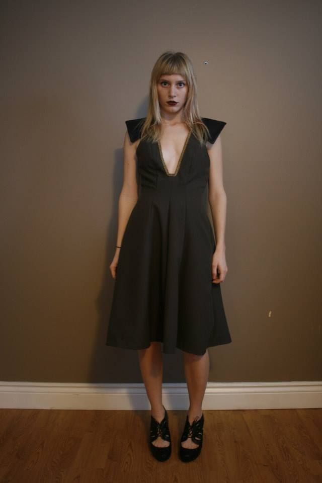 Fitted with flared skirt , deep square neckline, with leather detailed shoulders