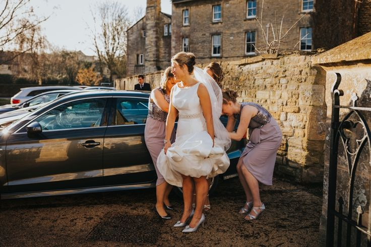 Final adjustments before the wedding begins - that's what amazing bridesmaids are for! Photo by Benjamin Stuart Photography #weddingphotography #weddingdress #bridemaids #weddingday #winterwedding #wintersun #bridalparty
