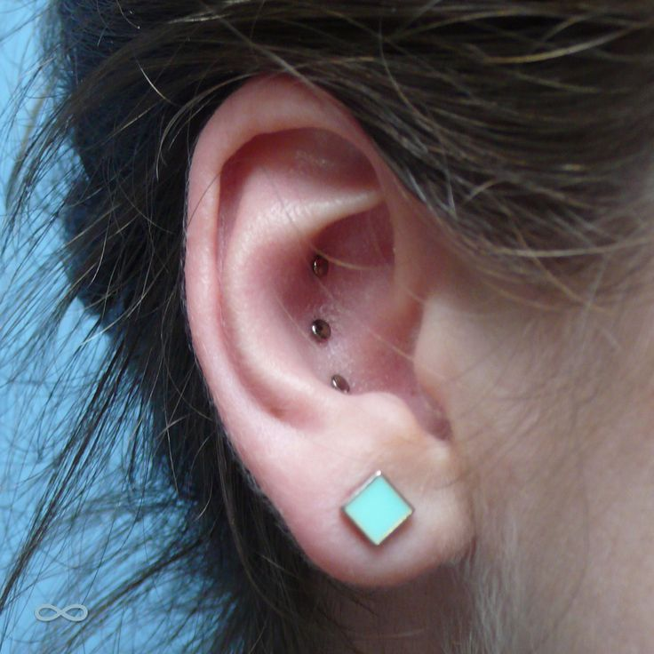 infinitebody: Healed tripple Conch piercing with...