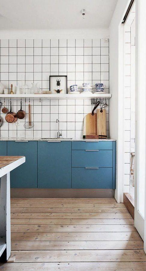 kitchen. large white square tile backsplash. no upper cabinets. color block.