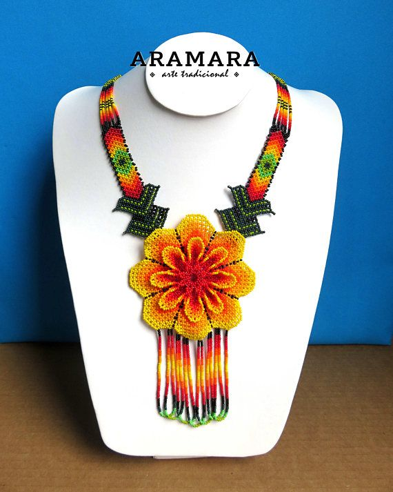 Dimensions Length 17 inches (43.18 cms) from point to point The diameter of the flower is 3.9 inches (9.90 cms) Earrings length is 2.4 inches (6.09 cms) The Huichol represent one of the few remaining indigenous cultures left in Mexico. They live in self-imposed isolation, having chosen