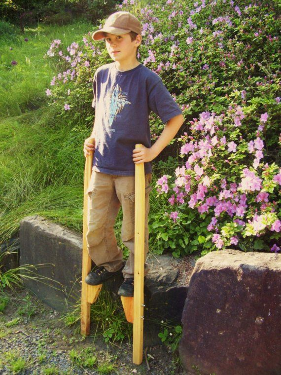 My g-pa used to make these for us...only they were quite a bit higher. Wooden Stilts by Heartwood Natural Toys
