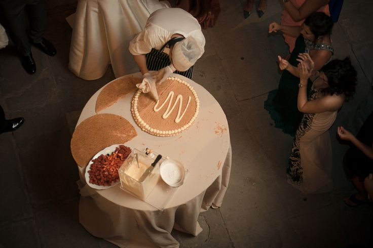 The preparation of the wedding cake in front of the guests