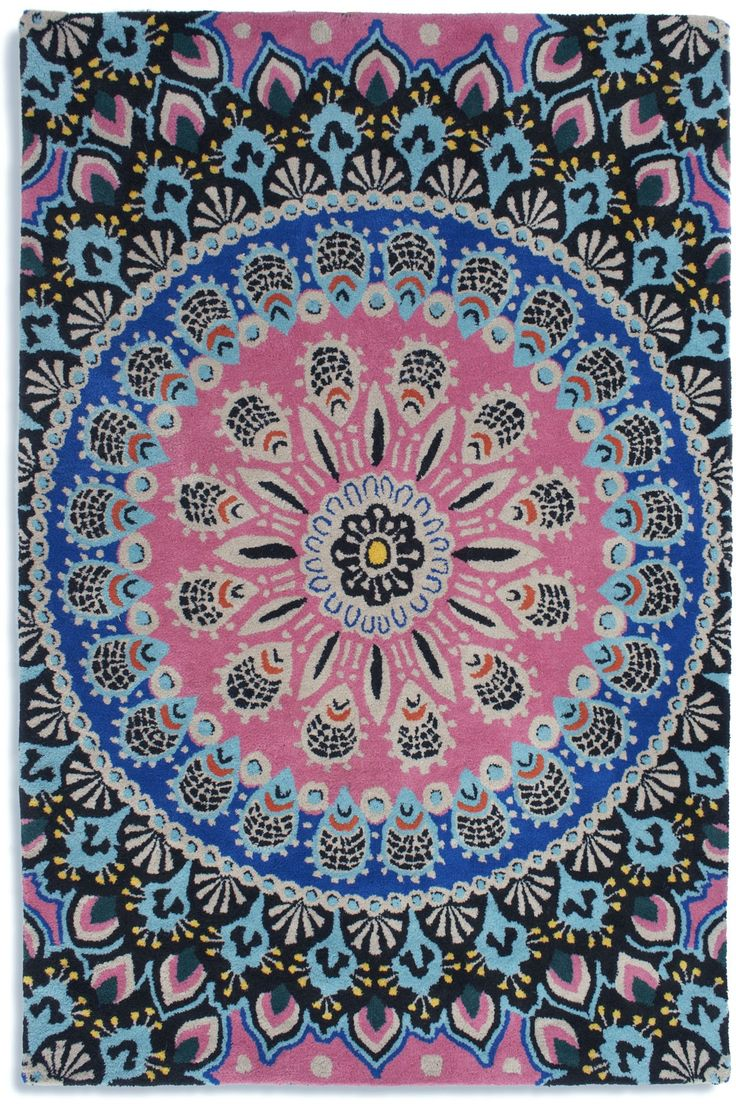NOMADIC from Plantation Rug Company. Inspired by peacock feathers. A vibrant palette of pinks, blues, greens and black sit together to create this jaw-dropping, must-have rug. Available in circle, too!