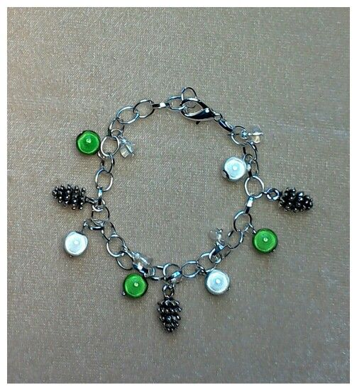 Christmas and winter season charm bracelet with miracle beads & pine cone charms.