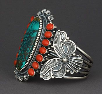 Beautiful cuff, I love the turquoise and orange with the intricate detail.