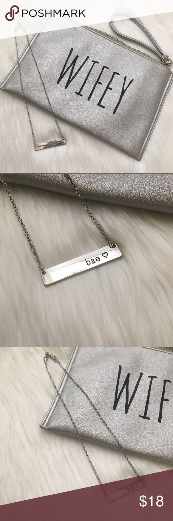 """Silver Duo Wifey Clutch and BAE Bar Necklace Super cute duo with this 16""""-18"""" adjustable bae necklace and wifey clutch by Deux Lux. Both gently used but tons of life left. Pics show some wear on the clutch. Make an offer or combine with other items in my closet to discount. Bags Clutches & Wristlets"""