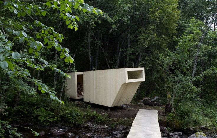 Nestled next to a small waterfall (and accessible by footbridge), this compact sauna is optimized for a calming reprieve. It can fit up to 12 people thanks to its double-deck benches and offers sun-kissed treetop views out its singular window. Formløs Architecture split the all-spruce structure into two halves: one for storing wood, the other for relaxation.