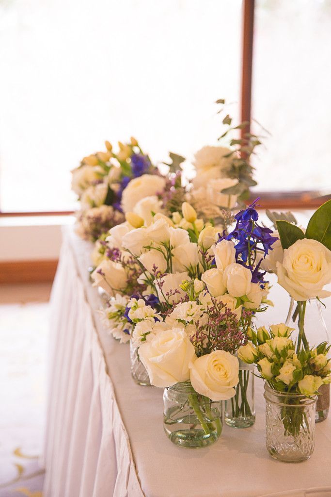 A Blooming Brilliant Wedding - Bridesmaid Bouquet, Boutonniere, Corsage, for Stef and David. Including a classic look for recycled glass jars with hand-tied bows, jute string, and tulips, pom pom chrysanthemum, roses, eucalyptus, lisianthus, iris, Australian Natives, jonquil, stattice, and misty,