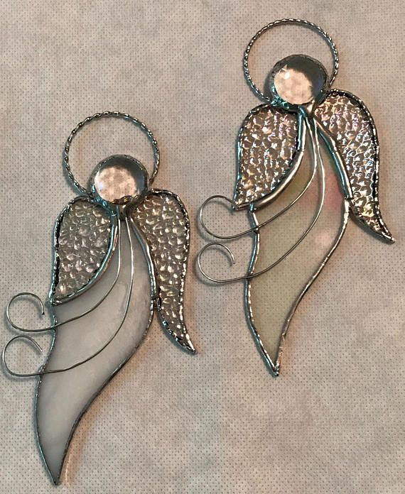 Pricing is for 1 Angel. Christmas Angels, Stained Glass Ornaments This beautiful Angel is approximately 2 1/2 x 6 1/2 in size. It has been created using stained glass, glass facetted jewels for the head, iridized glass wings and a braded halo. This photo shows different glass