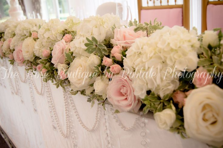 White and blush pink top table flowers with roses and hydrangea