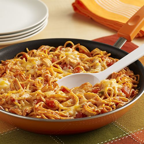 A pot-sized pasta recipe with the flavor of chicken enchiladas made with spaghetti in a skillet