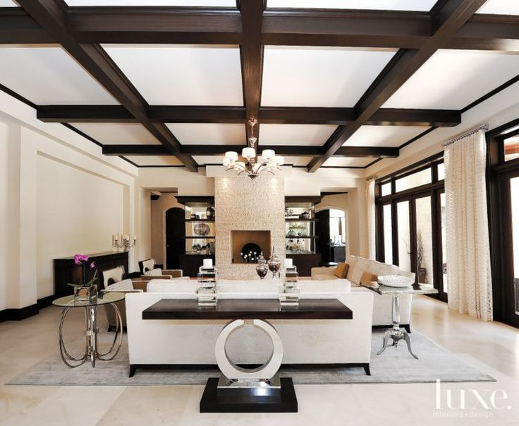 Living room with limestone surrounded fireplace | LuxeSource | Luxe Magazine - The Luxury Home Redefined