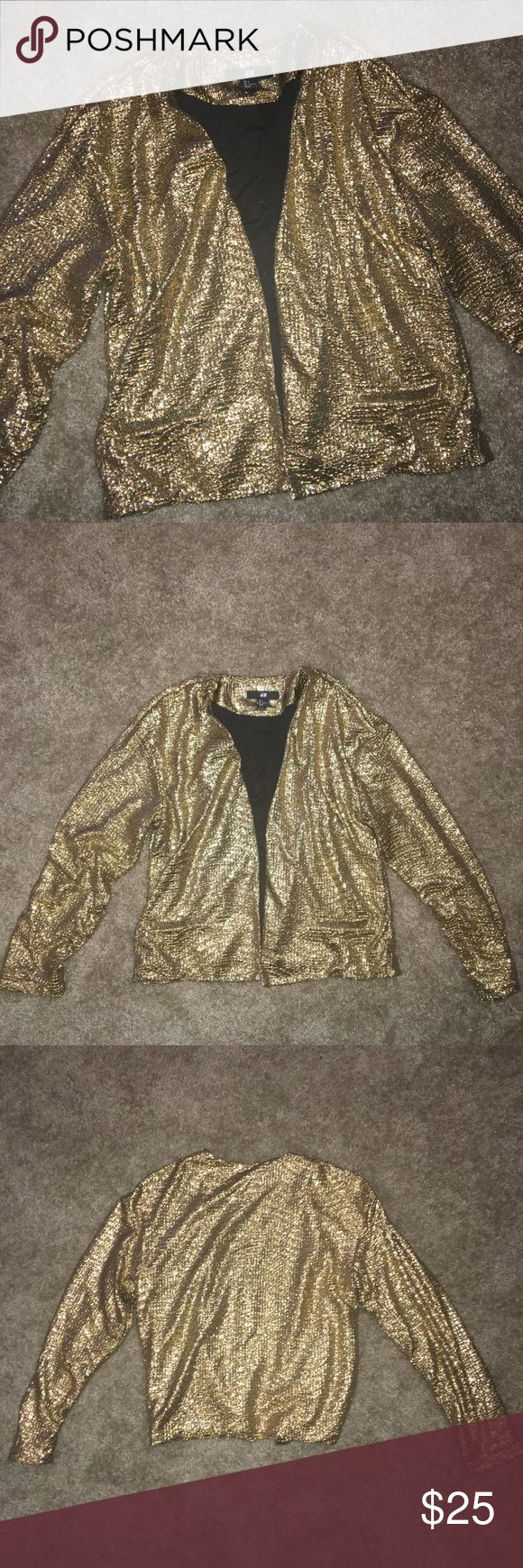 New H&M Metallic Gold Cardigan Jacket Small New without tags never worn.  Fully open in the front with no fastening.  Two small pockets in the front are not actual pockets.  Jacket is lightweight with midi sleeves that stop right above the wrist.  Pit to pit is is 17.5 inches.  Sleeves are 21 inches, measurement from shoulder to bottom is 21 inches. H&M Jackets & Coats