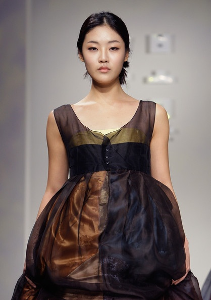 Korean Style: A Model walks down the catwalk during the South Ko… - SparkRebel
