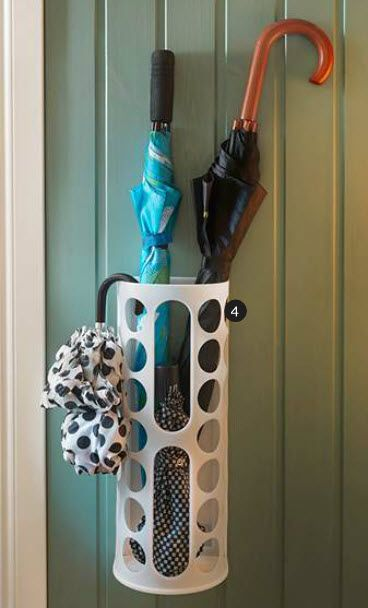 Ikea plastic bag holder/storage solution works in the landing strip area as a clever wall-hung umbrella holder.